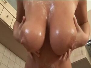 sexy MILF Pandora plays with her monster boobs