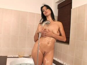 Lara Stevens plays with her pussy while taking a