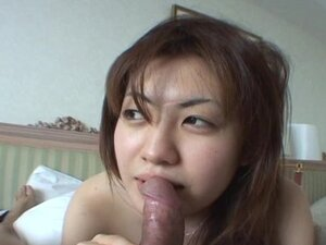 Asian tramp sucking hard on the fat dick real