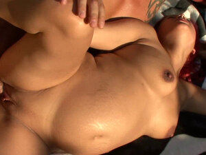 Sexy pregnant redhead is outdoors sucking and