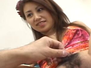 Asian babe shaving her hairy pussy