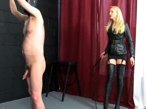 Blonde mistress dominates two male slaves,