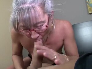 Horny mature woman with glasses takes a big cock