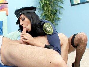 Busty brunette in a cops uniform heels and fishnet