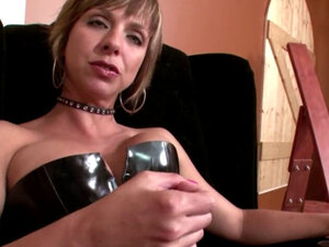 domina is posing in sexy leather boots and talking